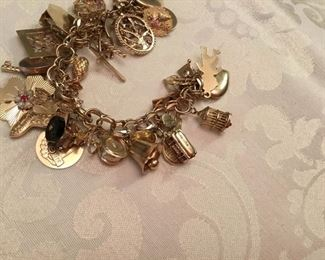14kt yellow gold charm bracelet - 90 grams
