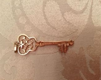 14kt rose gold key pendant