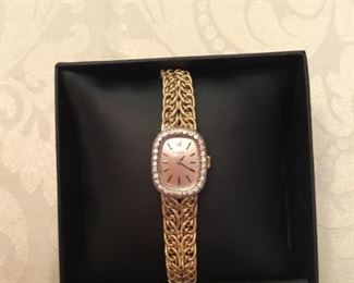 14kt yellow gold rope bracelet a Rolex ladies & diamond bezel.