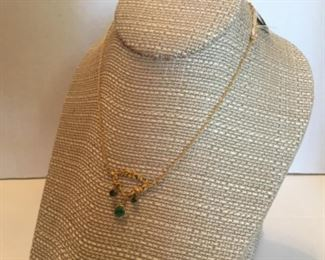 14kt gold necklace & 3 African emeralds.