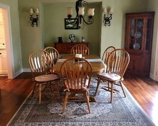 Birch dining table with two leafs, six arrow back chairs,   Classic Huntboard and Glass Front Corner Cabinet, 9x12 Royal Kingdom rug