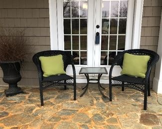 Two outdoor chairs, small glass top table, urn