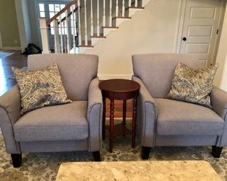 Two matching contemporary chairs, small wood table