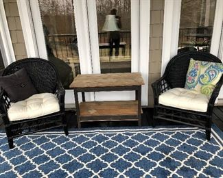 Blue Safavich porch rug 8 x 10, rattan and wicker chairs