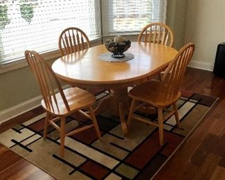 Oval table with four matching chairs, Orian rug  5 x 7