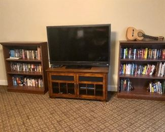"""Two matching book cases and glass front TV stand, 52"""" Sony TV, lots of science fiction books!"""