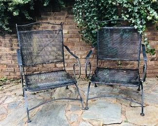 Two heavy metal chairs