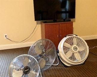 fan collection, TV and small cabinet