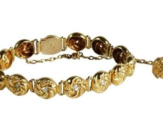 3. Nice Yellow Gold Love Knot Diamond Bracelet