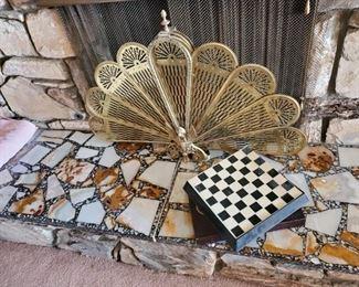 Brass peacock fireplace