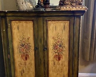 Converted tv armoire with shelving. Could be used for books or shoes. $250