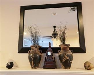 Mirror, vases