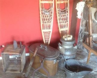 Variety of vintage items: copper tub, milk crate, milk can, coal bucket, ice tongs, irons, snow shoes, metal sunbeam iron in container