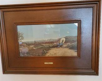 wood paneled, framed western pic