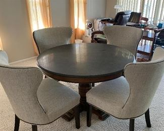 "45"" round dinning table with pedestal and slate too and 4 clothed chairs. NEW. POTTERY BARN! $500."