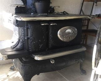 Gorgeous!! Completely refurbished full size Glenwood cast iron stove with all original parts Ready to start cooking!