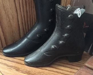 Store advertising cast iron boots