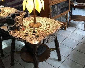 Slag lamp on heavily carved parlor table