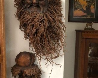 Carved tree root spirit faces