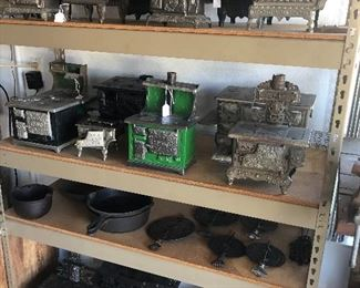 Huge collection of miniature cast iron stoves