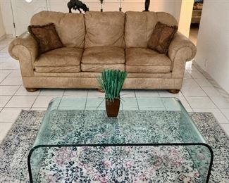 Glass Waterfall Table and Leather Sofa offered by Susie's Estates
