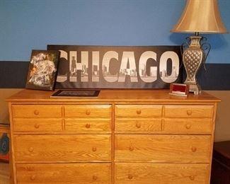 Large wood dresser. Chicago skyline and sports art. Lamp.