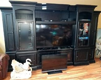 Black entertainment center. Tons of storage. TV not for sale