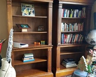 Three wood bookcases with gorgeous crown molding.