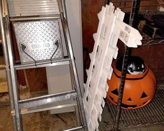 Garage misc. In back - folding bench. painter ladder. Garden trim