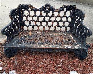Cast metal outdoor bench (yes...it does have legs...they are sunk into the soil!)