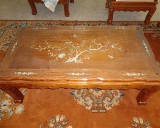 Rosewood w/MOP inlay coffee table and beautiful Orange rug