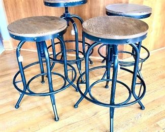 Wood and metal adjustable height, swivel barstools with foot rest.