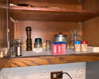 A few different assortments of kitchen items as well as a collection of salt and pepper shakers