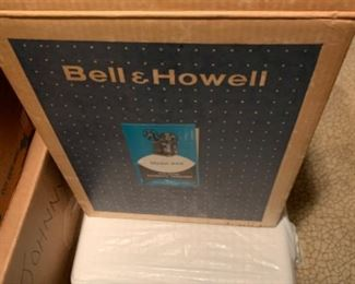 Bell & Howell projector as well as projection screen