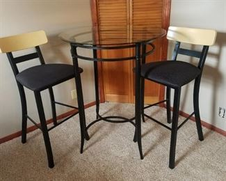 Fun pub table and two bar height stools. Perfect for your game room!