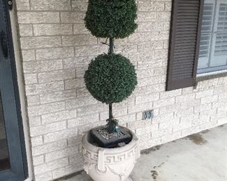 Two matching artificial shaped trees in concrete planters