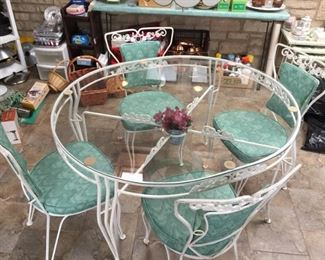 Beautiful wrought iron glass table with 4 chairs $200