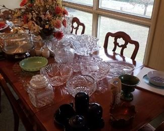 Large scalloped-edge glass platter, Fire-King jadite bowl, cut glass serving bowl, crystal serving bowl-frosted fruit motif, crystal serving bowl-modern shell motif, crystal pear covered jar, divided crystal plate, pressed glass pitcher, blown glass pitcher-Crate & Barrel