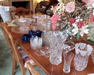 Apple-shaped luncheon plates, matching apple-shaped salad/dessert bowls, navy Fiesta creamer & sugar with underplate, and salt & pepper shaker set, silk floral centerpiece, crystal serving bowl & matching platter/cake plate, polished silvertone pedestal cake plate with glass dome, detail of vases