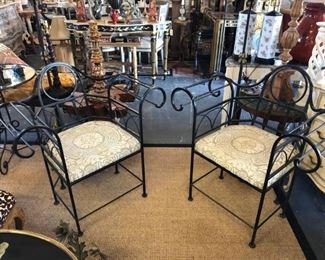 Unusual pair of wrought iron armchairs