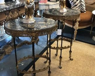 Pair of 19th century bronze candlestands with oval marble tops.