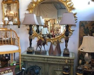 Huge giltwood sunburst mirror, painted credenza with aged mirrored top.
