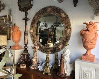 Round seashell encrusted mirror, pair fine terracotta urns, pair pricket sticks, blue coral.