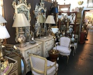 Pair of painted nightstands, pair of painted Italian Venetian mirrors, pair of 19th century painted and parcel gilt Louis XV fauteuils, pair of silvergilt finial lamps.