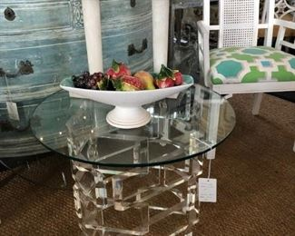 Stacked block Lucite table with round glass top.