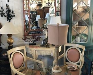 Pair of painted Italian armchairs, painted Chinese demilune console, Lucite occasional table with brass accents, Travertine Art Deco lamp, painted pagoda form mirror.