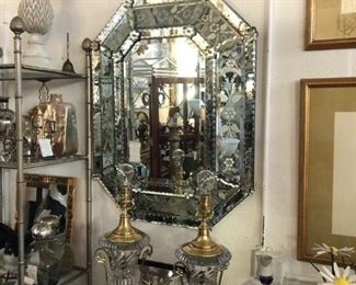 Octagonal Venetian mirror, pair of Baccarat urn-form lamps by Paul Hanson.