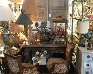 Pair of 19th century walnut fauteuils in leopard, 19th century walnut table, pair of carved fragment panels.