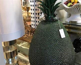 Oversized glazed terracotta pineapple.