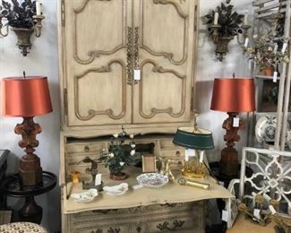 Painted seretaire, pair of bronze floral sconces, pair of finial form table lamps, bouillotte lamp with oval tole shade, painted 19th century armchair with pieced back.
